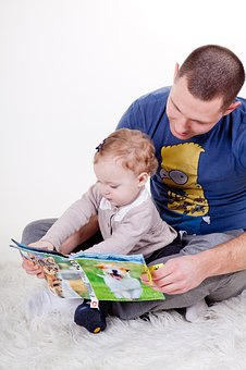 Dad Reading With Baby